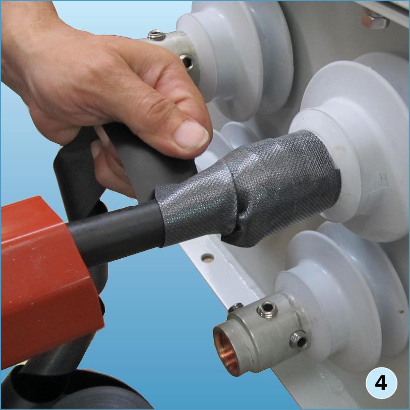 Обмотать провод ППС при помощи «скотча 23» в два слоя, начиная от юбки проходного изолятора